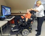 Power Wheelchair User With Home Assistive Technology