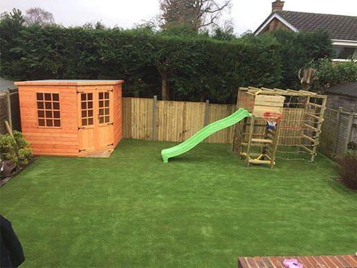 Artificial Plastic Grass Installation In Garden