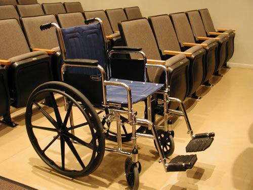 How do I get Medicare to cover a wheelchair?