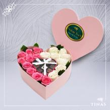 A beautiful flower box of pink and white roses and a set of chocolates decorated and sold by TINAS