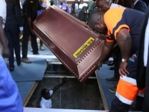 Robert Mugabe buried in a steel coffin as family claims people are 'after his body'